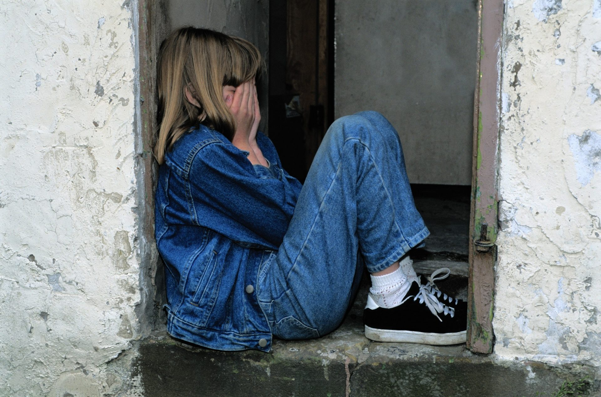 Child in a doorway crying