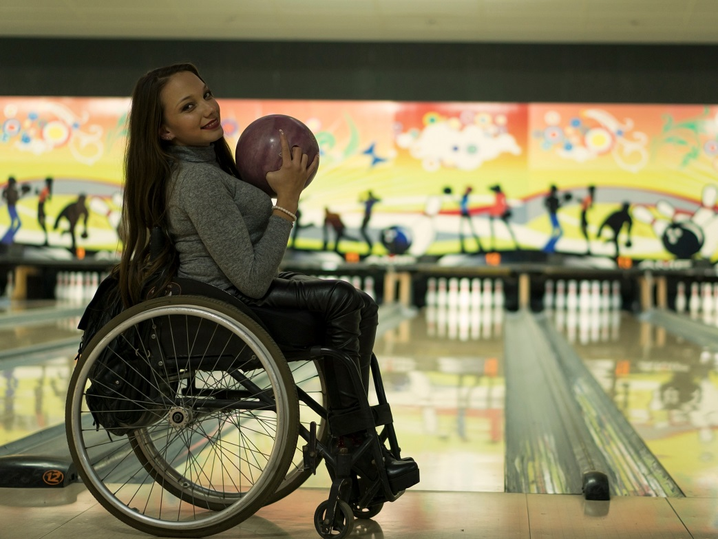 Photo of woman in wheelchair with a bowling ball